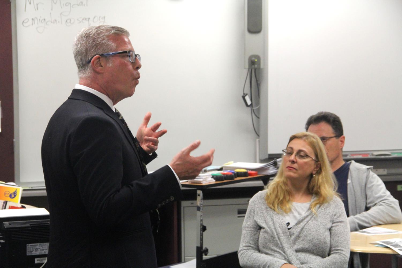 Teacher+Eric+Migdail+explains+his+curriculum+to+parents.