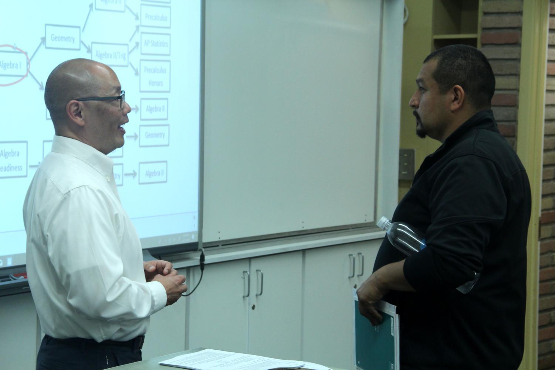 Math+teacher+Robert+Tsuchiyama+addresses+a+parent.