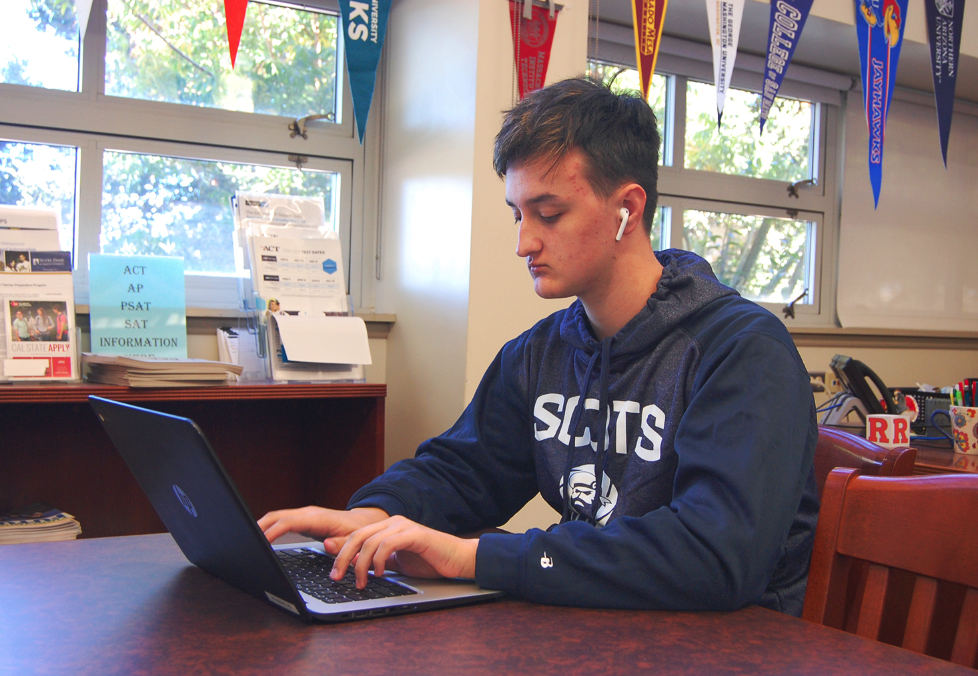 Senior Nick Mattas works on his laptop in the College and Career Center during lunch.