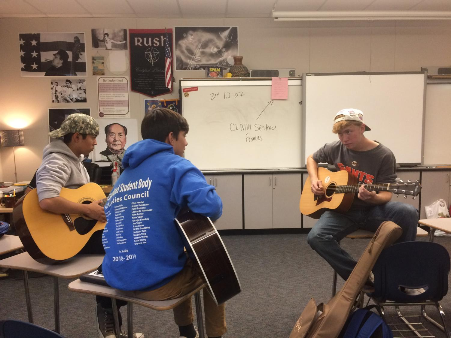 Members of the Guitar Club jam together during lunch in E7.