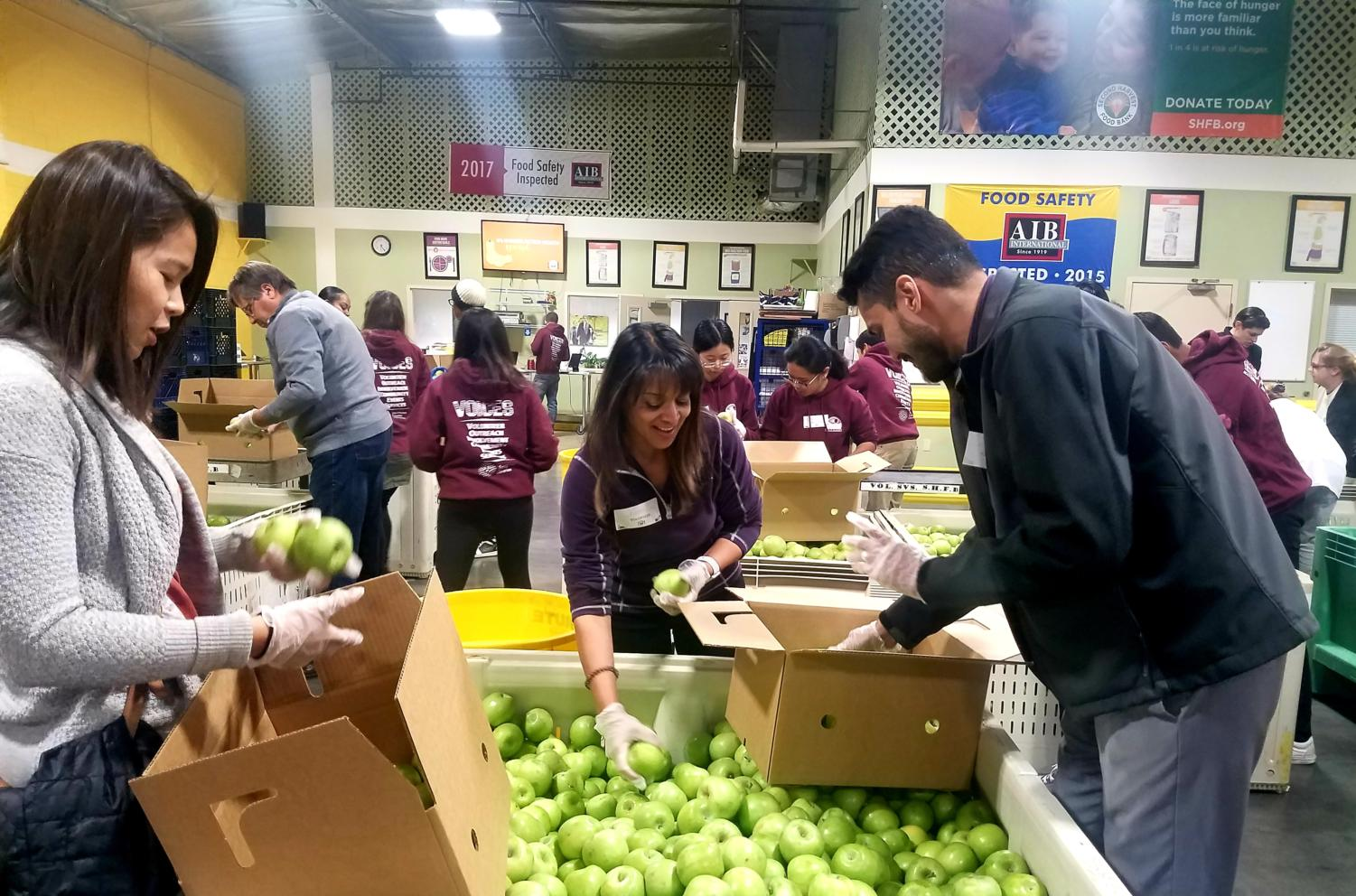 Volunteers at the latest event sorted apples for families for the holiday season.