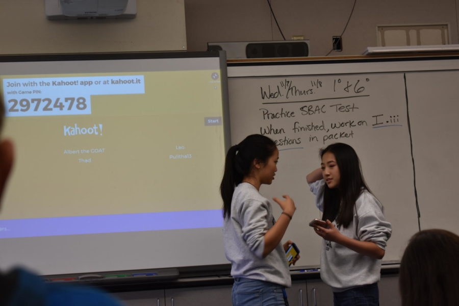 Selena+Sun%2C+a+junior%2C+and+Denise+Zhou%2C+a+junior%2C+discuss+club+progress.