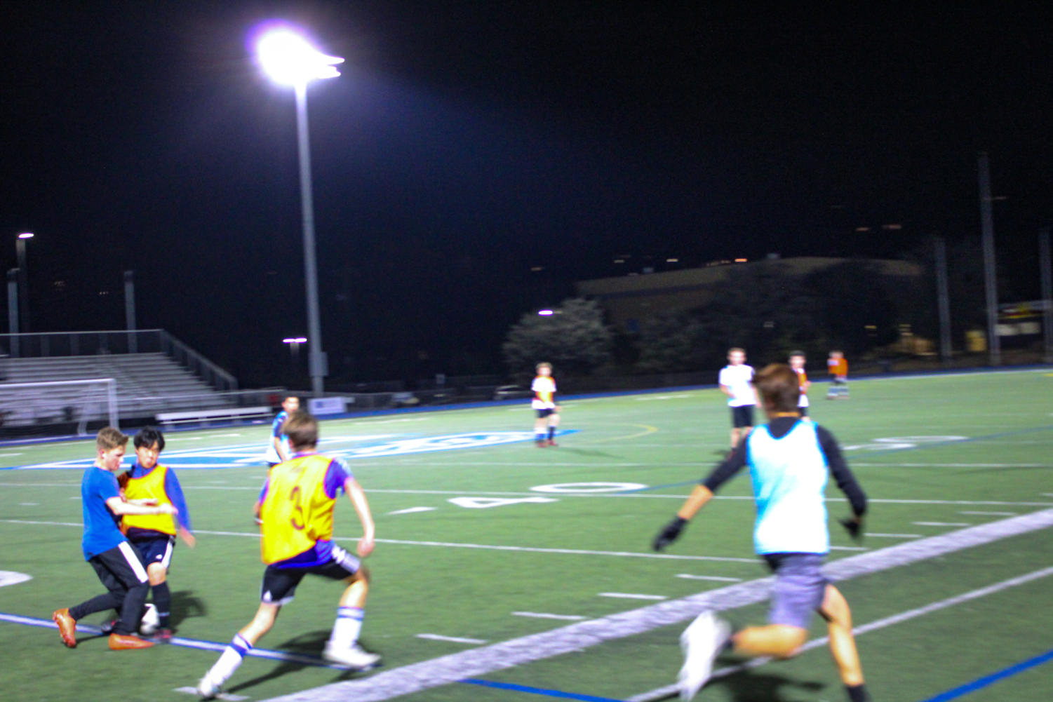 Freshman Alexander Viatchenko-Karpinski nutmegs a defender in midfield during a scrimmage.