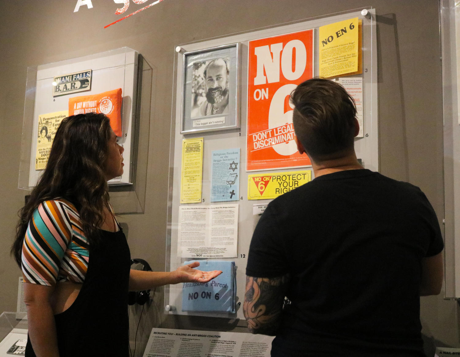 Jewelana+Wilson+%28left%29+and+her+wife%2C+Christina+Webb+%28right%29%2C+look+at+posters+and+propaganda+at+the+GLBT+Historical+Society+Museum%27s+exhibition+on+the+Briggs+Initiative.
