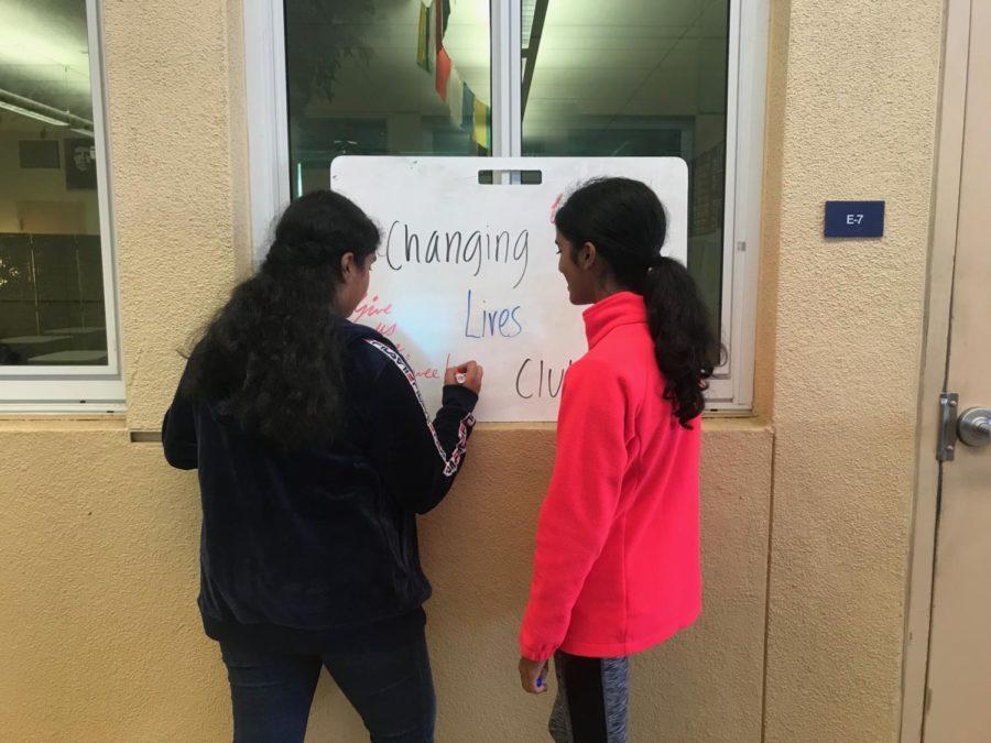 Sarga+Nair+and+Varsha+Raj+create+the+sign+for+the+Changing+Lives+Club.