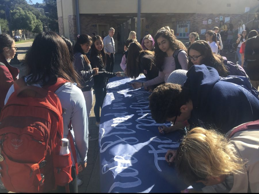 Students+sign+a+poster+to+show+their+support+against+anti-Semitism.+