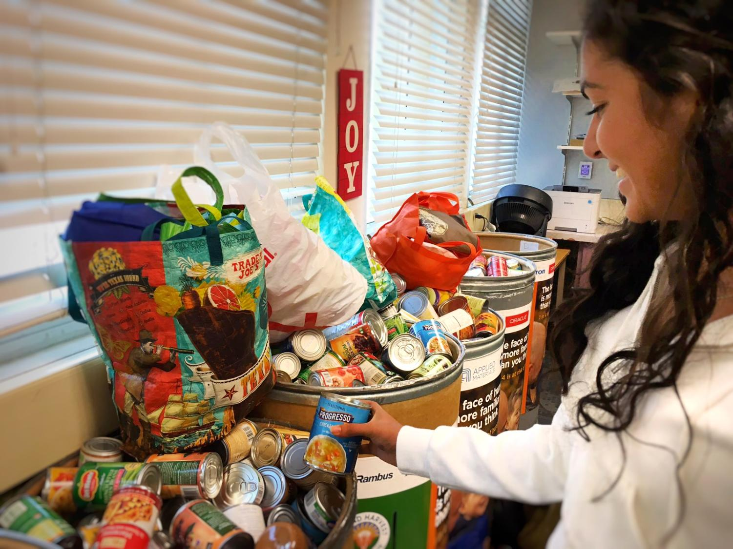 Soni Kanaya, a junior and member of ASB, organizes and prepares the canned food donations for collection.