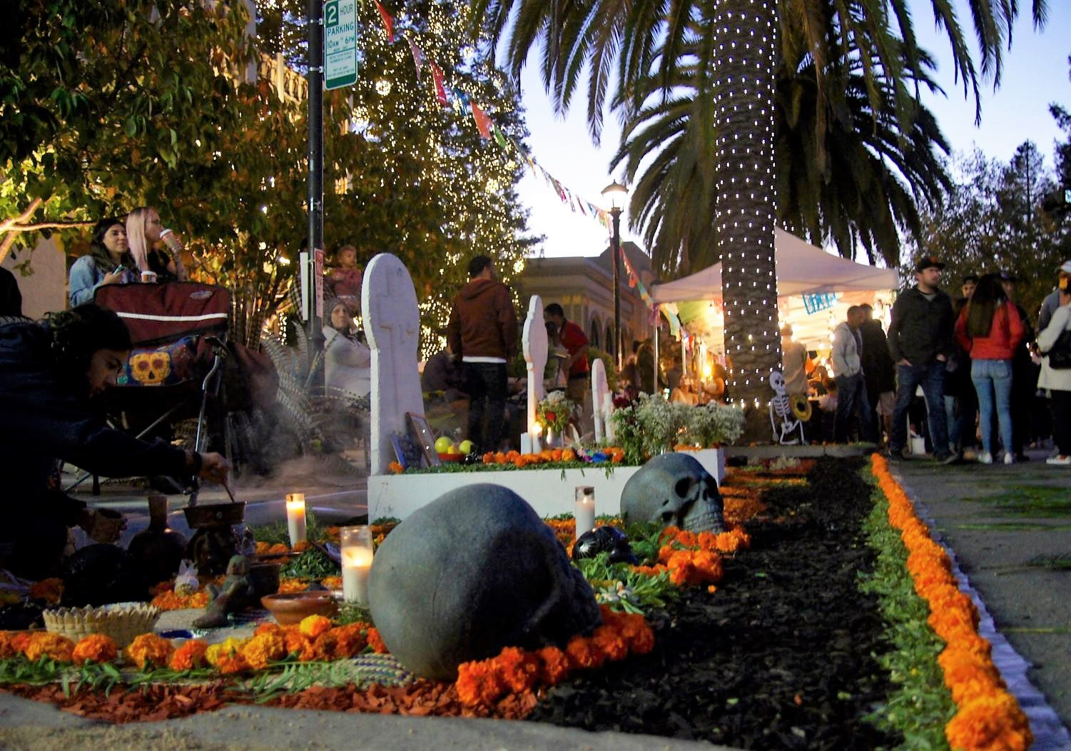 An ofrenda with burning incense and Aztec marigolds pays respect to the loved ones who have passed away.
