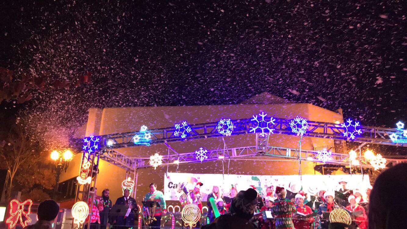 Fake+snow+sprinkled+out+to+the+audience+as+many+groups+performed.