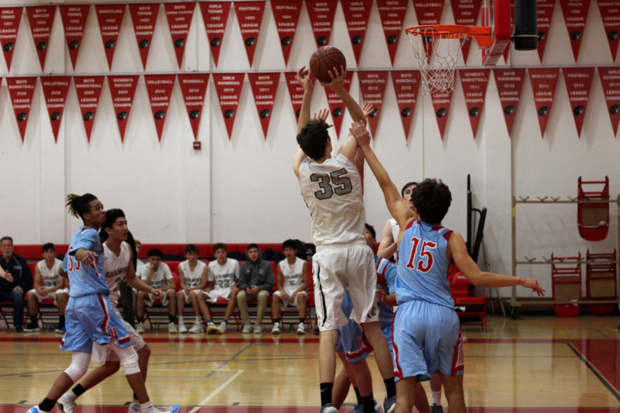 Ben+Ledwith%2C+a+senior%2C+gets+fouled+as+he+goes+up+for+a+jump+shot.