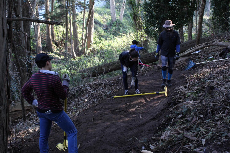 Freesia Finn, Chanel Gruevarra, and Mikayla Acosta volunteer at the Laguna Honda community trail project.