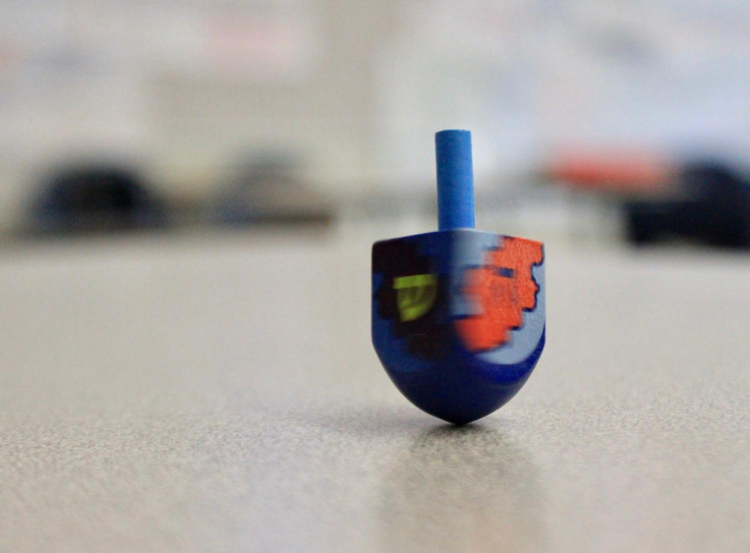 A dreidel spins on a desk in C14.