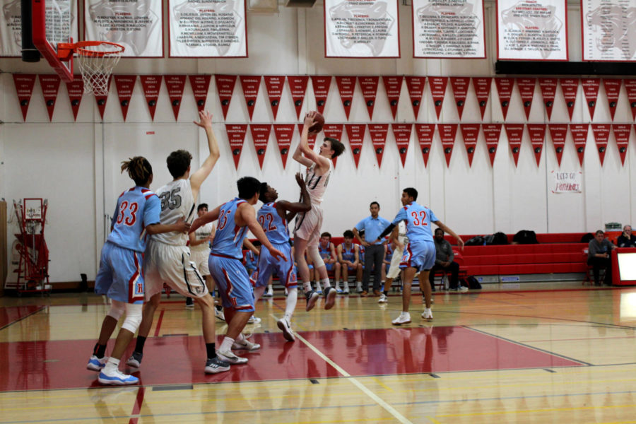 Boys varsity basketball knocks Hillsdale Knights off their steeds