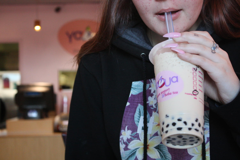Sydney Schortgen, a sophomore, casually sips her jasmine milk boba tea after school.