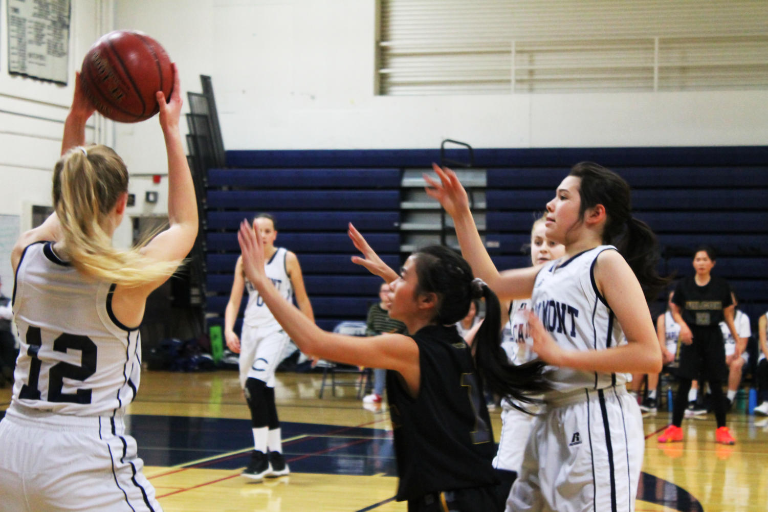 Nicole Olazar, a junior, looks to find an open teammate to pass the ball to.