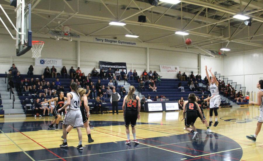 Ashley+Trierweiler%2C+a+senior%2C++shoots+a+3-point+basket+in+the+third+quarter.