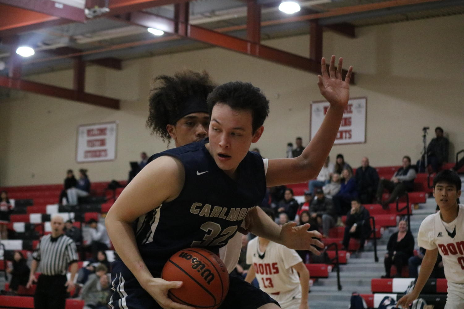 Grant+Acker%2C+a+senior+and+center%2C+looks+for+an+%0A+open+teammate+to+pass+to+under+the+basket.