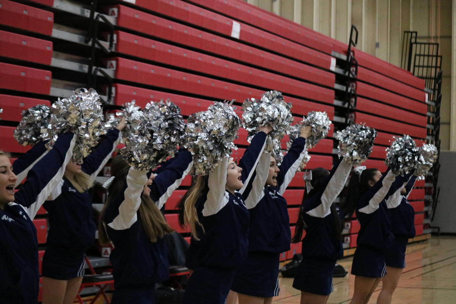 Carlmont+Cheer+supports+the+basketball+team+by+keeping+the+spirit+up.