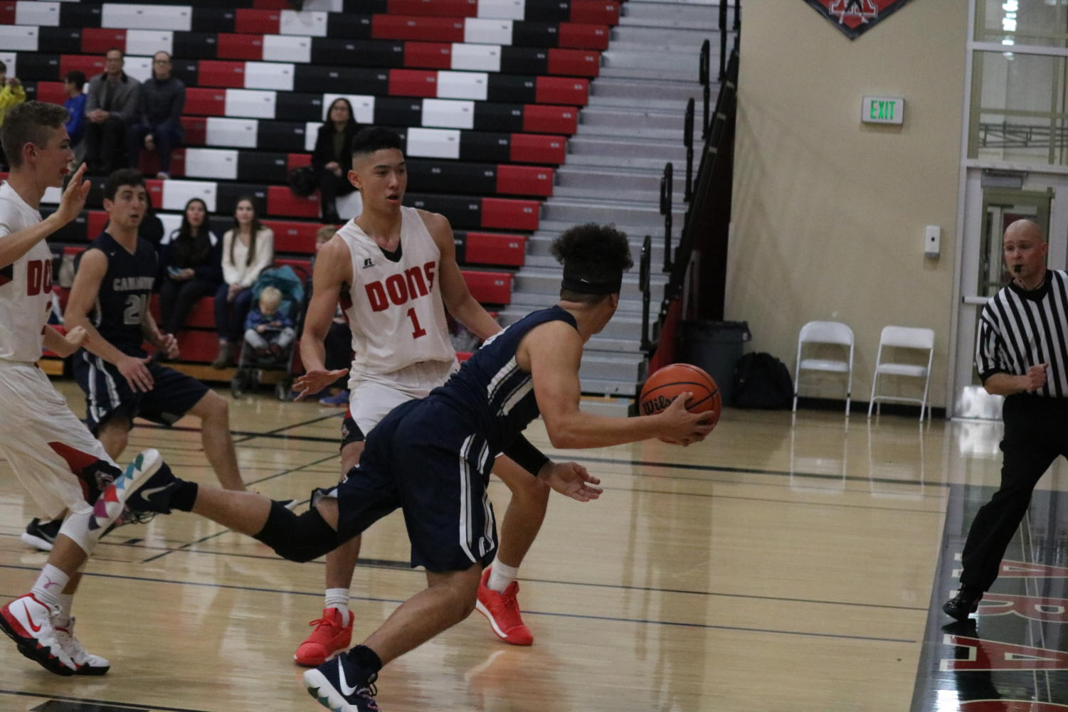 Lajuan+Nelson%2C+a+senior+and+shooting+guard%2C+attempts+to+pass+the+ball+before+going+out+of+bounds.