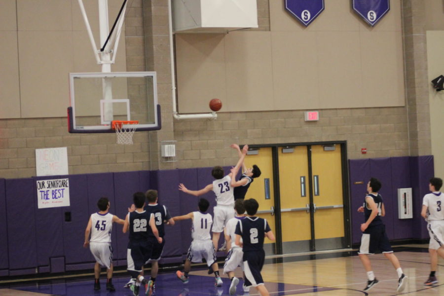 Awad+gets+fouled+mid-shot.