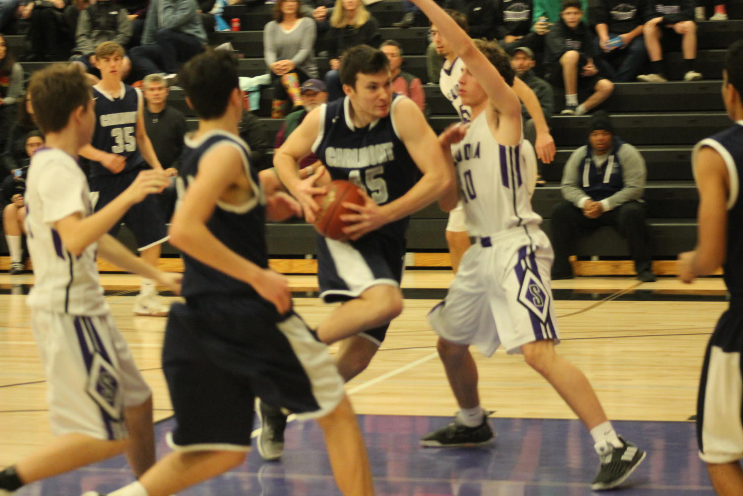 Sophomore center Will Hesselgren attempts a layup through Sequoia defenders.