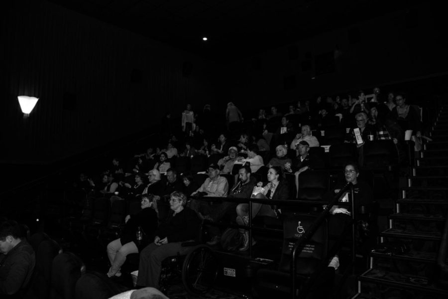The+audience+beginning+to+sit+down+to+begin+the+film.