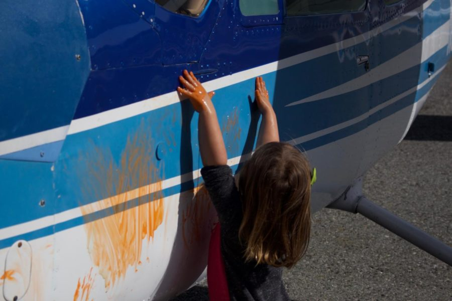 Kennedy+Rout+paints+an+airplane+with+orange+paint.+There+were+many+interactive+exhibits+at+the+museum.