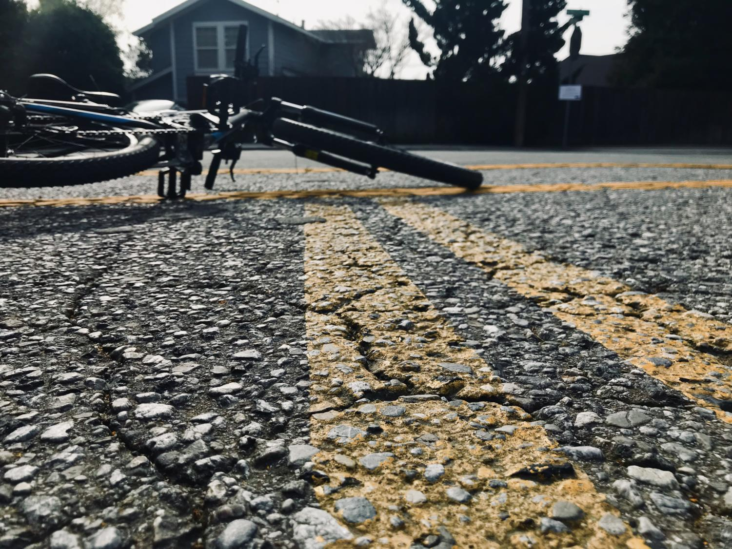 Cracks in roads can cause bike accidents.