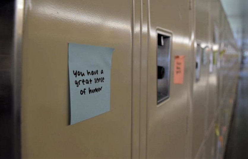 Sticky+notes+with+kind+messages+are+posted+on+every+locker.+