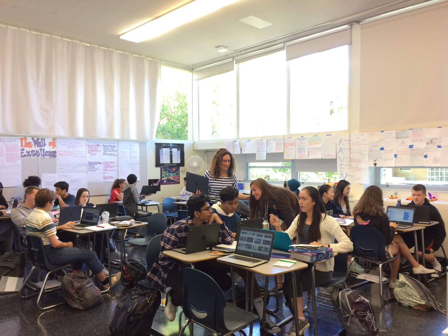 Cindy Shusterman supervises her AP Seminar class currently engaged in group work.