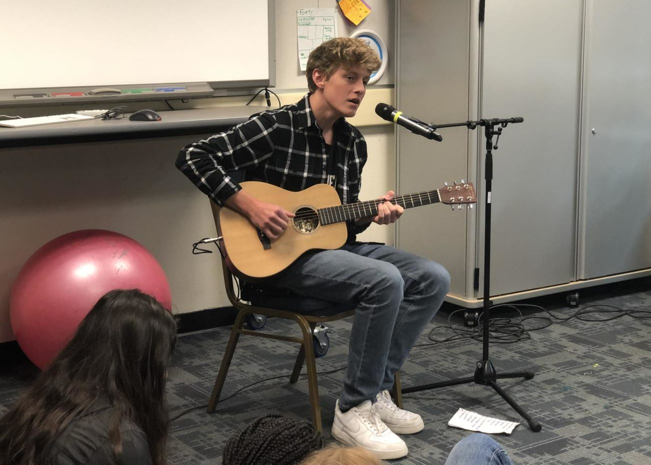 Keegan Dyer, a sophomore, sings to