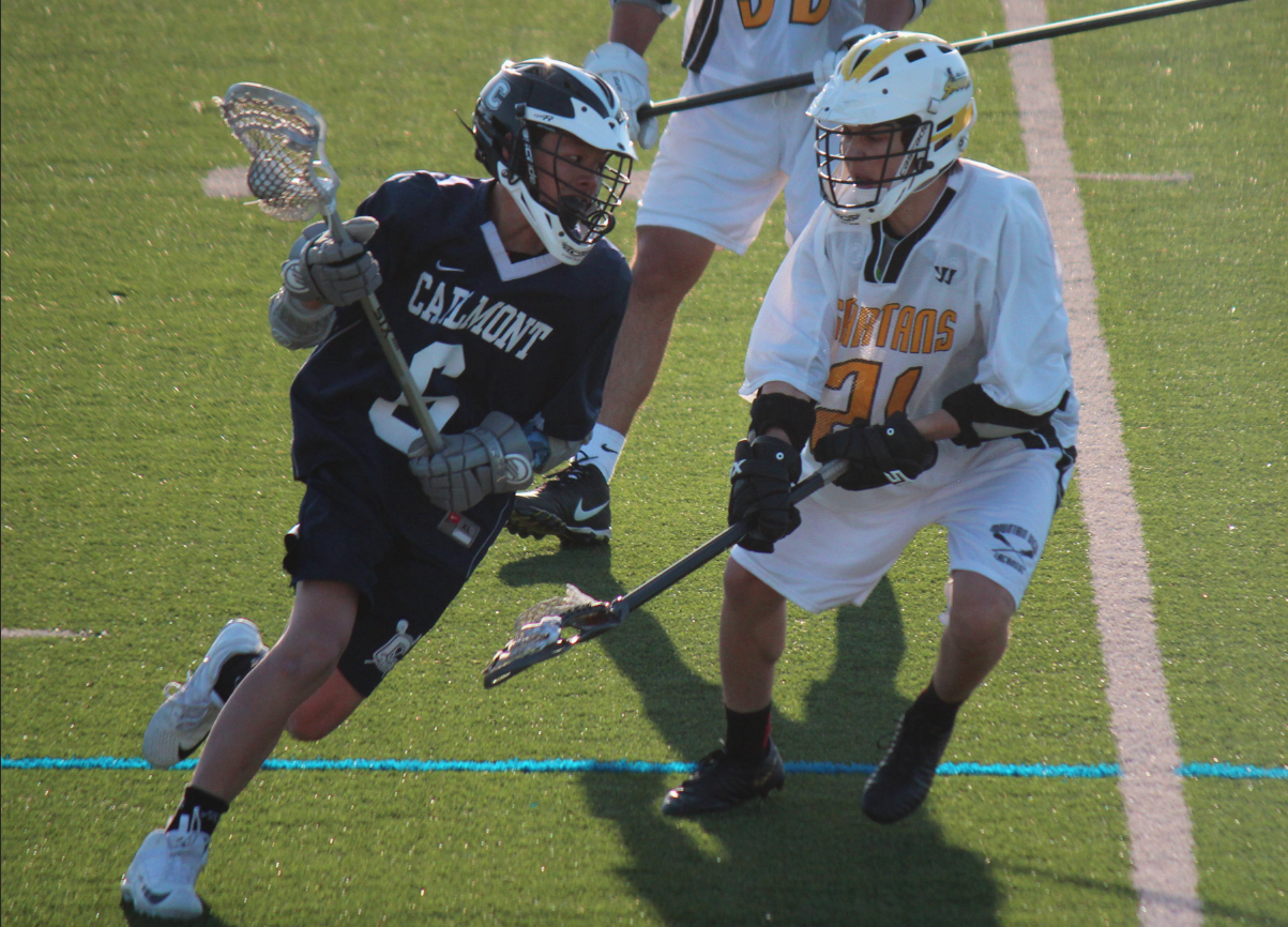 Carlmont attacker Ethan Madsuda runs past a Mountain View defender. Carlmont would go on to beat Mountain View 11-2.