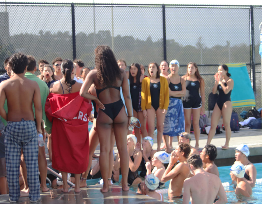 The+Scots+swim+teams+meet+up+by+the+shallow+end+to+perform+their+cheer+during+a+meet+against+Burlingame.
