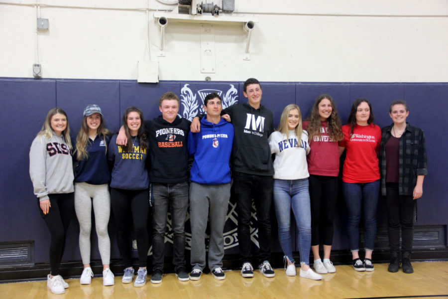 Carlmont+senior+athletes+get+together+for+a+picture+at+the+college+signing+ceremony.