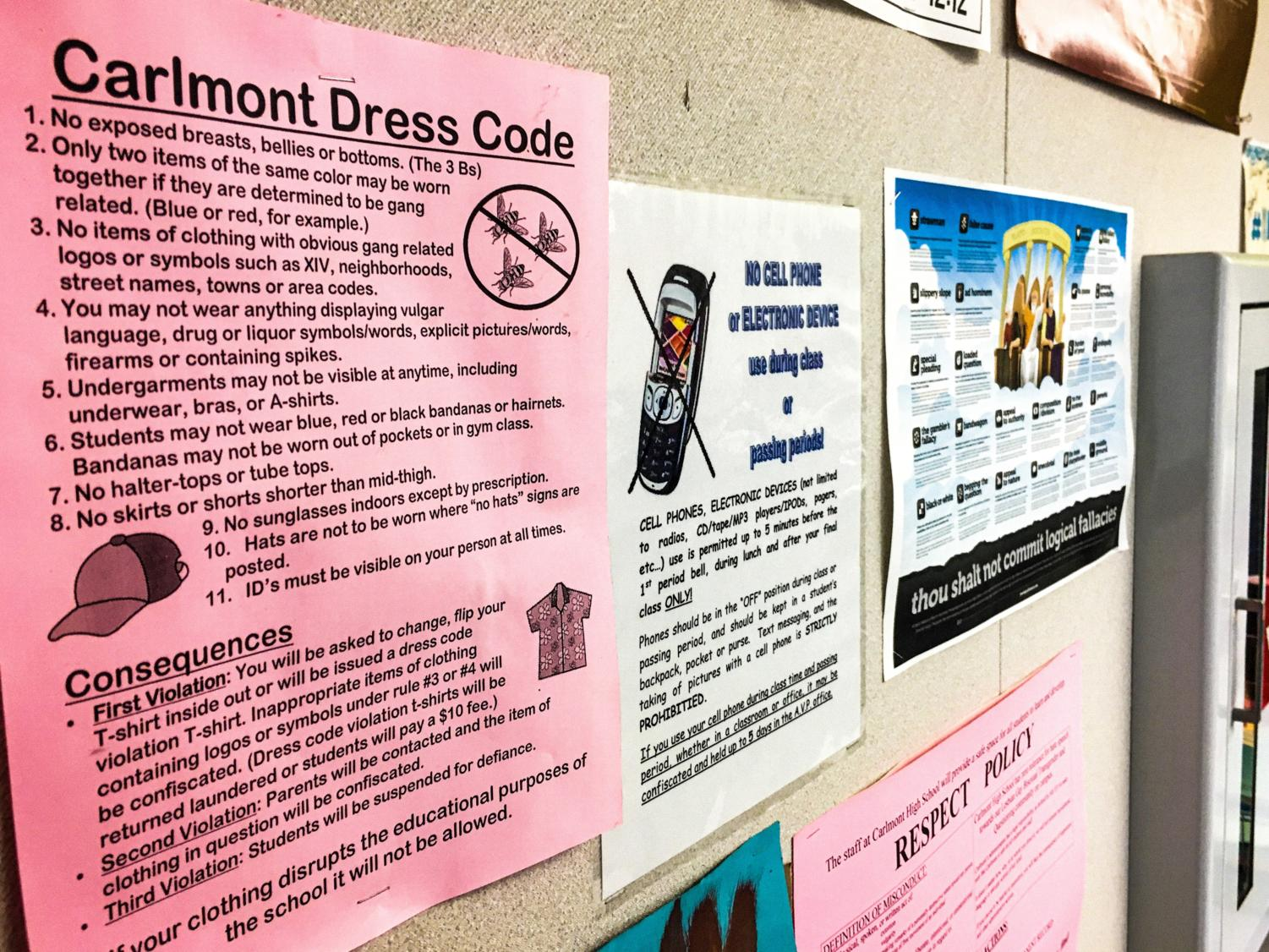 A print-out of the Carlmont High School dress code is displayed in Denise Steward's classroom.