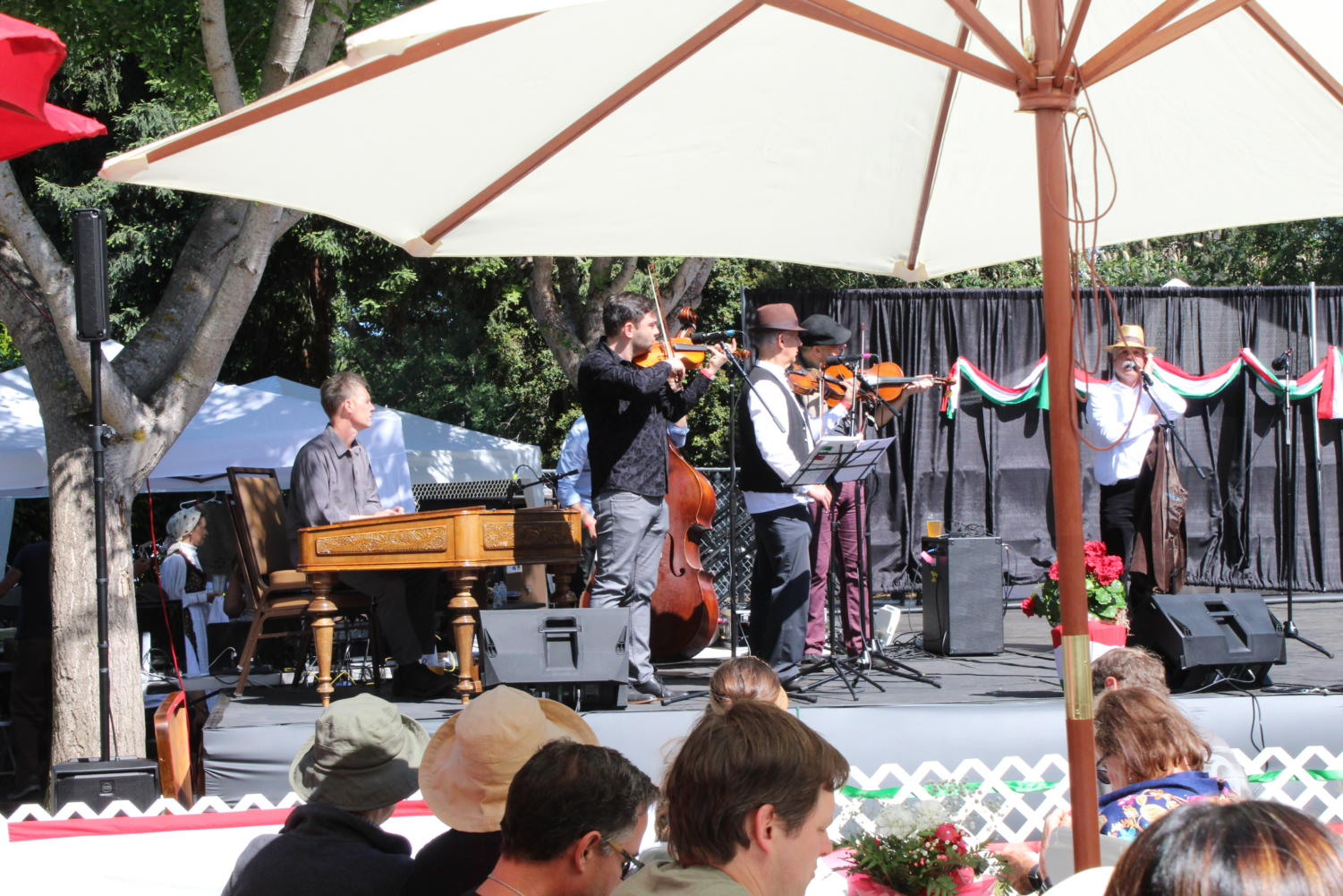 Bands play Hungarian music from the stage to liven up the event.