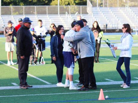 Carlmont coaches congratulate seniors on their hard work.