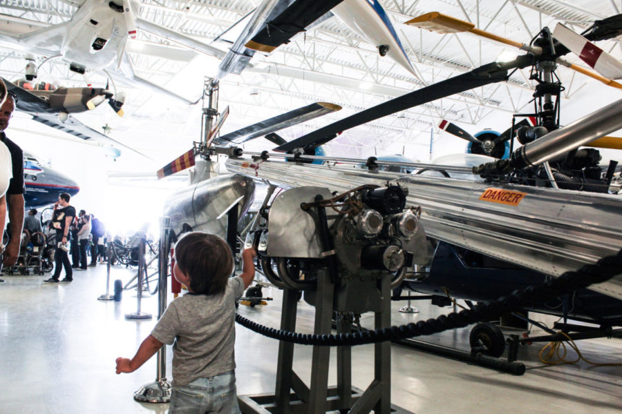 A+child+explores+a+plane+exhibit+in+the+museum.+