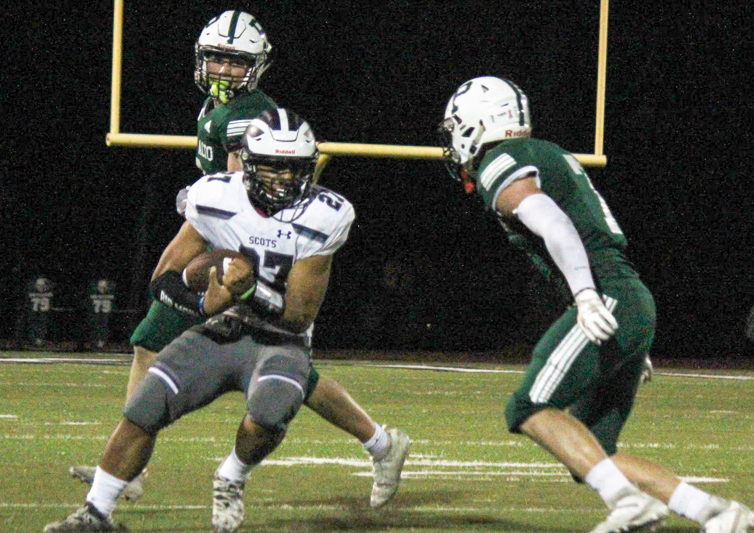 Dane Fifita, a sophomore, makes a move on a Viking defender.