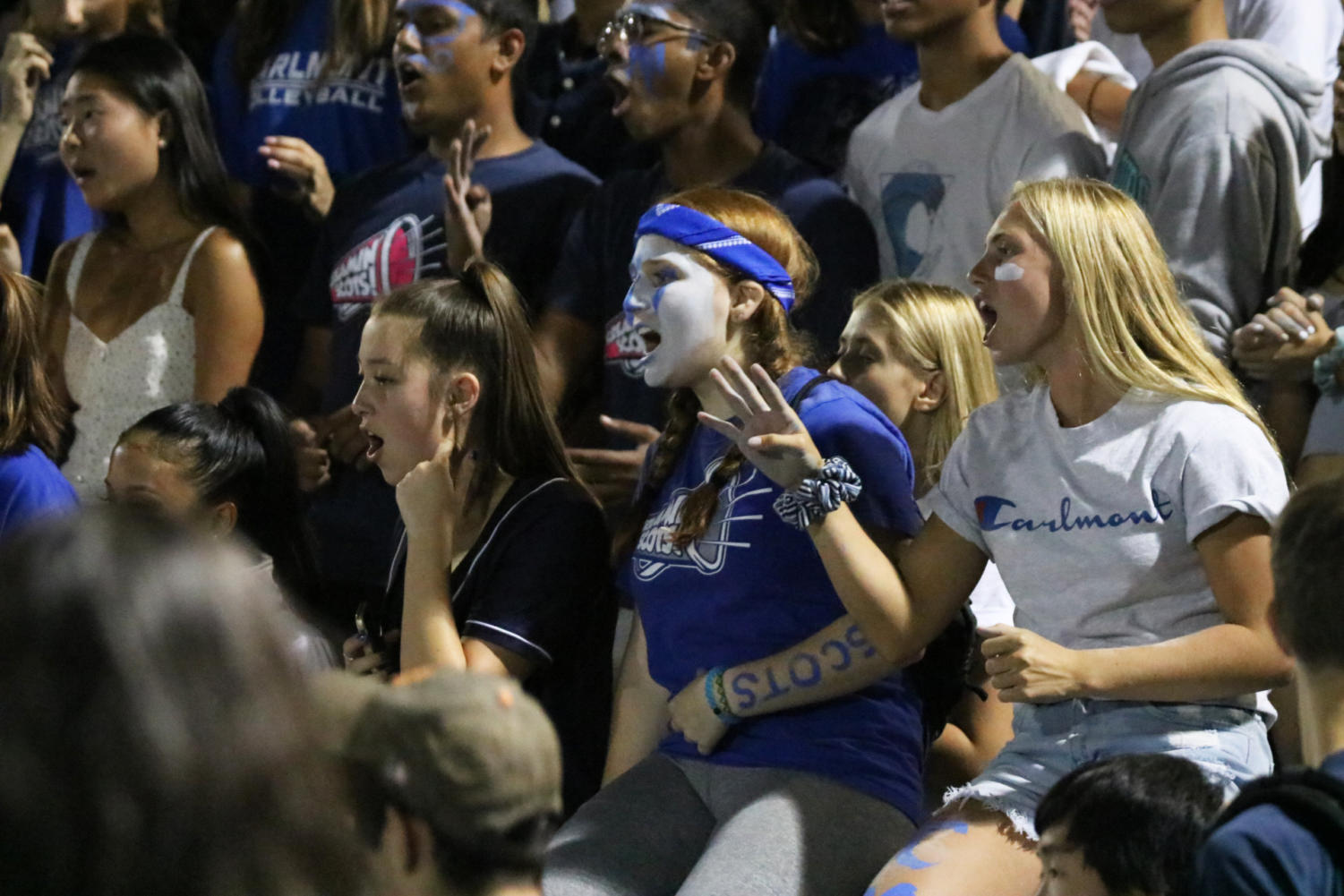 Hundreds of students lined up along the bleachers, cheering for the Scots in blue and white face paint and glitter. Friday was Carlmont's first home game of the season and with a final score of 69-19. The win also marked the second consecutive victory for the Scots.