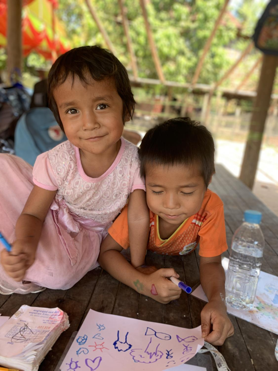 A+Cambodian+brother+and+sister+smile+for+the+camera.