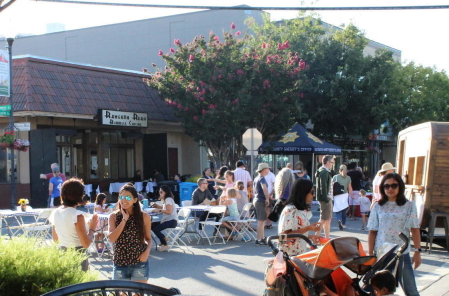 People+gather+on+the+corner+of+Laurel+Street+as+the+event+kicks+off.
