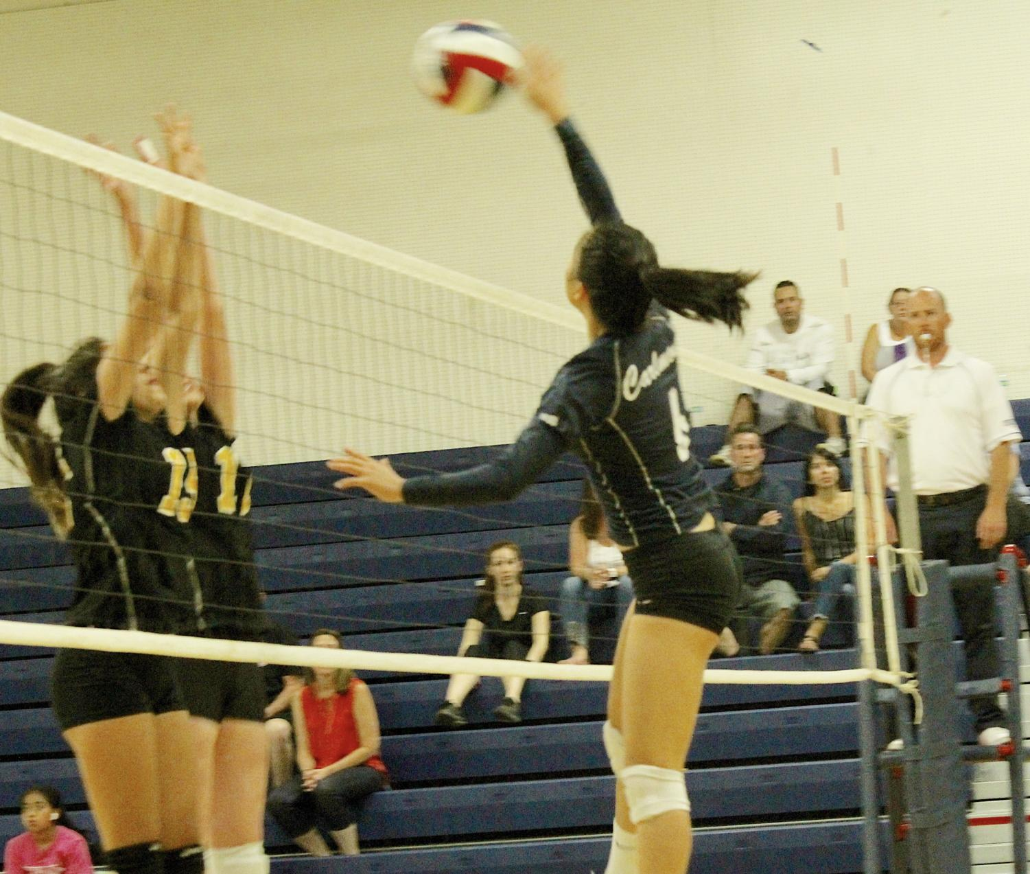 Claire Tseng, a sophomore,    spikes the ball in the first set.