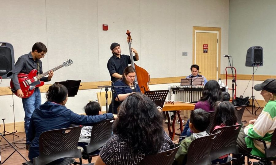Enrique+Rojas+on+guitar%2C+Alex+Farrell+on+bass%2C++Mark+Davis+on+trumpet%2C+and+Shura+Taylor+on+guzheng+are+performing+in+the+Belmont+Library.