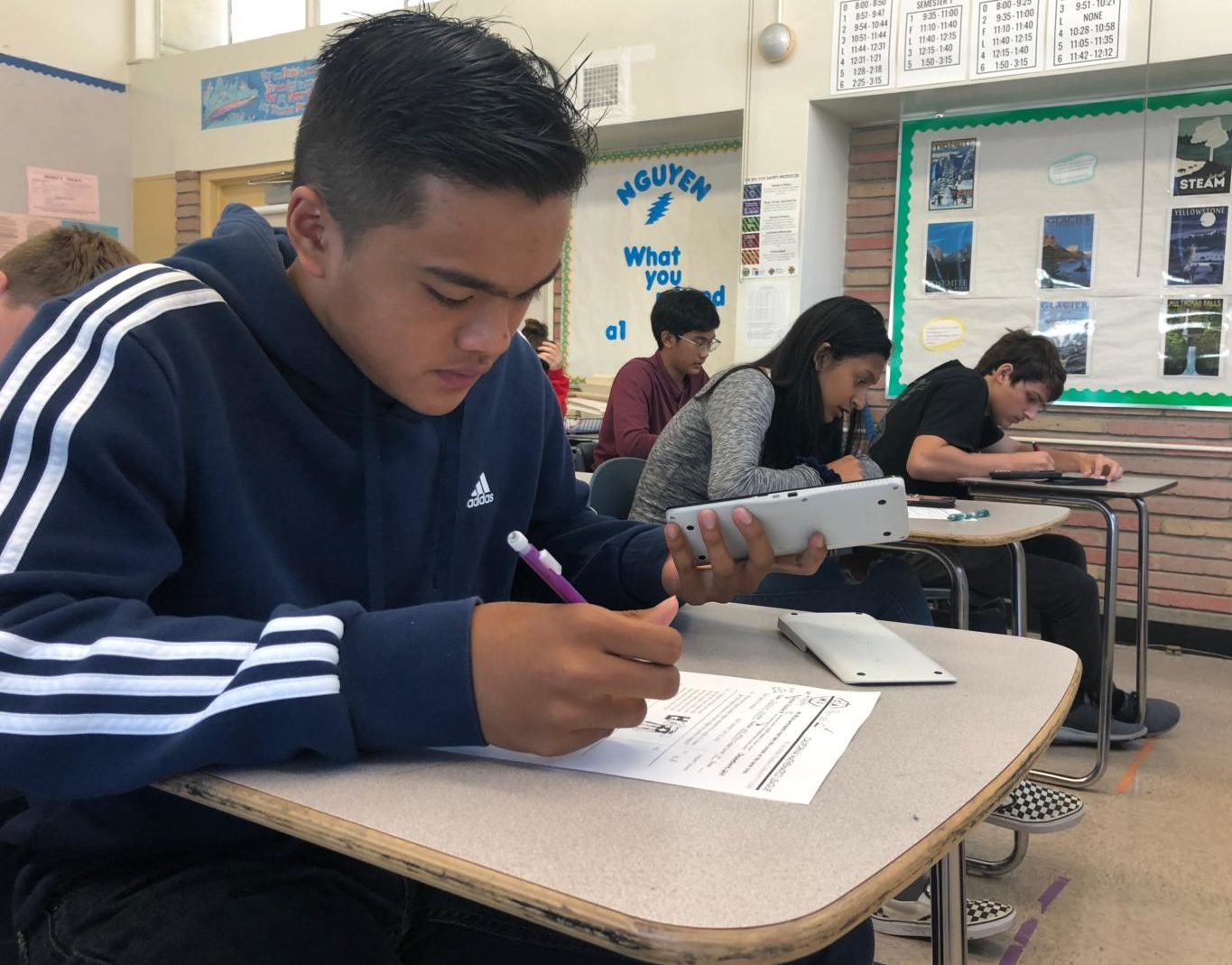 Joshua Yglesias, a sophomore, works on a math problem during the first math contest of the year.