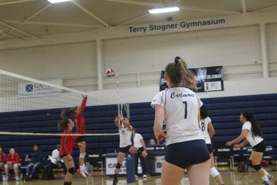 Amanda+Fraser+runs+across+the+court+to+set+the+ball.+