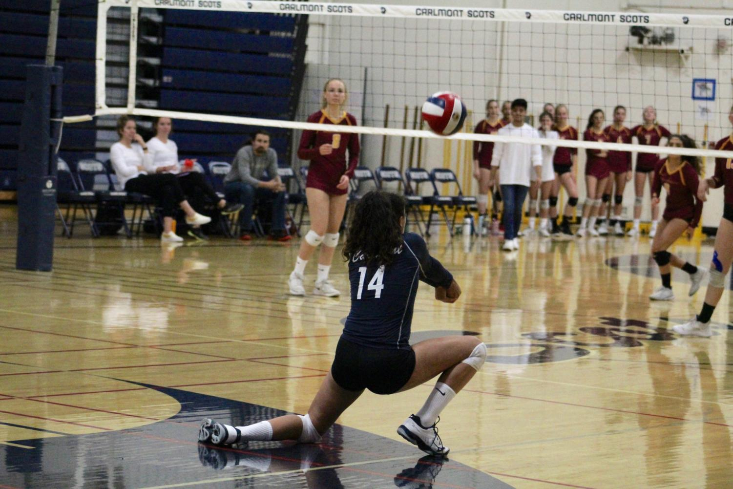 Freshman Curly Raddavero gets low in order to reach a pass from the opposing team.