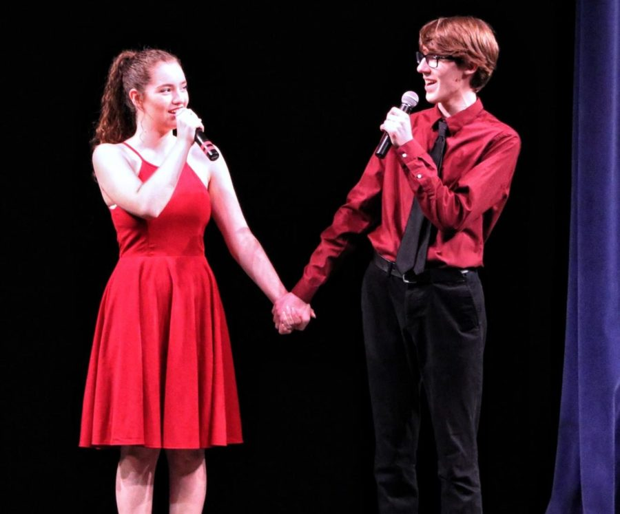 Katie+Mannion+and+Colin+Welter%2C+both+seniors+and+co-presidents+of+choir%2C+sing+%22Somewhere%22+from+%22West+Side+Story%22+by+Leonard+Bernstein.