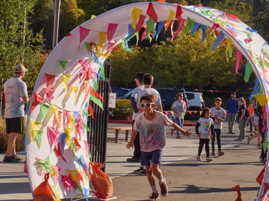 A+student+crosses+the+finish+line+for+the+Color+Run.