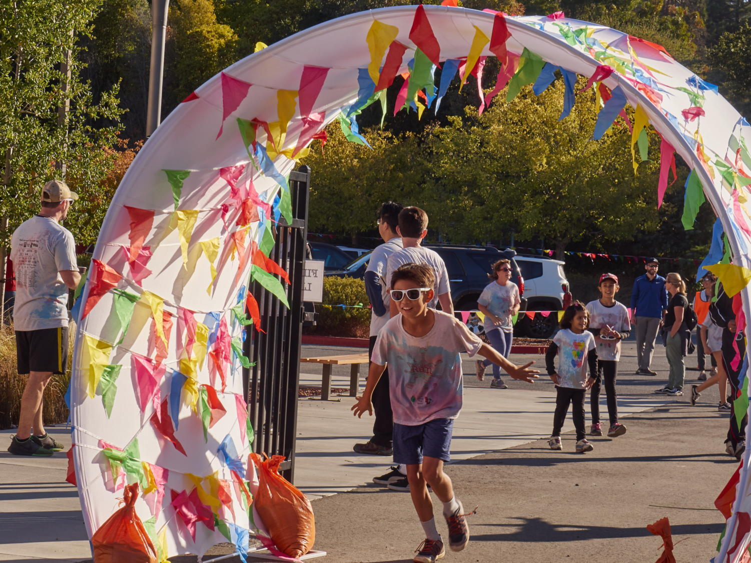 A student crosses the finish line for the Color Run.